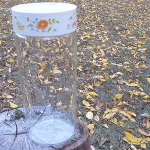 Floral lid tall Pyrex storage cylinder